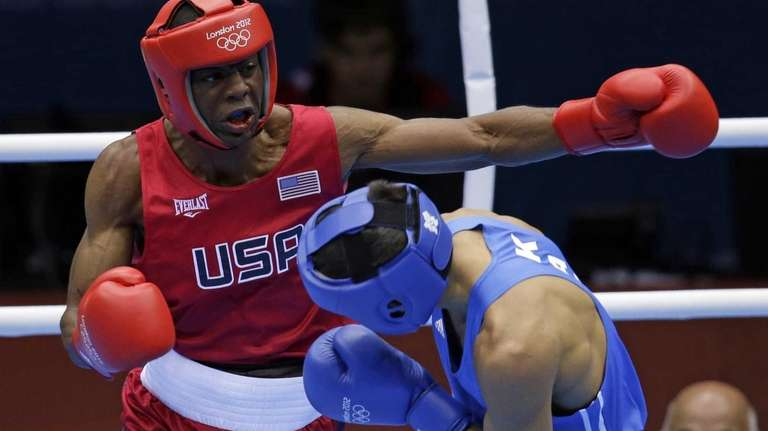 United States' Jamel Herring, left, fights Kazakhstan's Daniyar