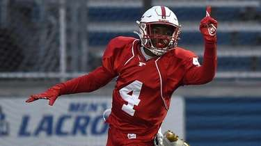 Freeport quarterback Terrance Edmond reacts after rushing for
