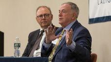 Regent Roger Tilles, right, speaks during a meeting