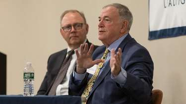 Regent Roger Tilles, right, speaks during a meeting