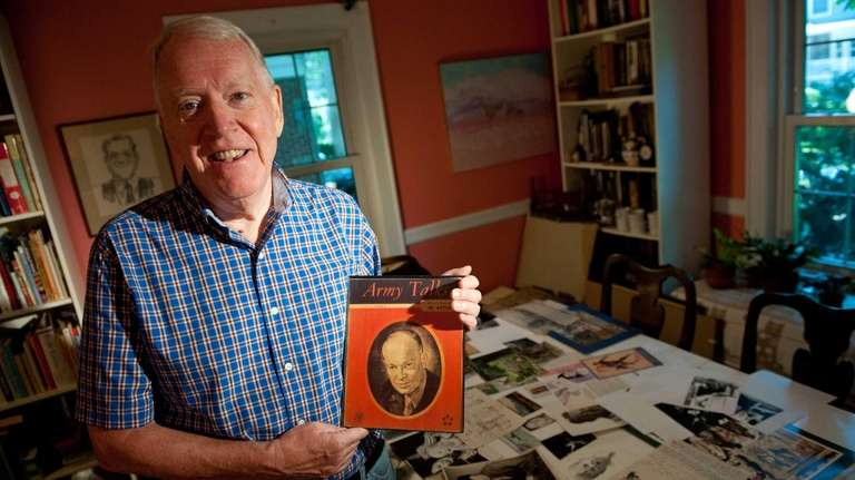 Brian Withers shows his father's portrait of Gen.