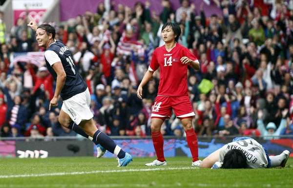 United States' Abby Wambach, left, celebrates after scoring