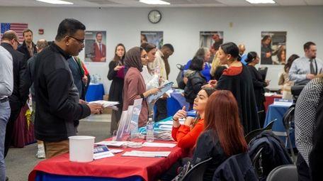 Job applicants attend the job fair at Joseph