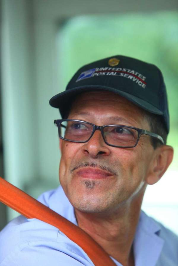 US Mail Carrier Mario Serrano, who helped save