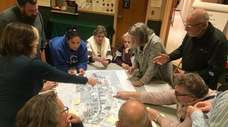 Riverhead residents separated into groups to discuss the