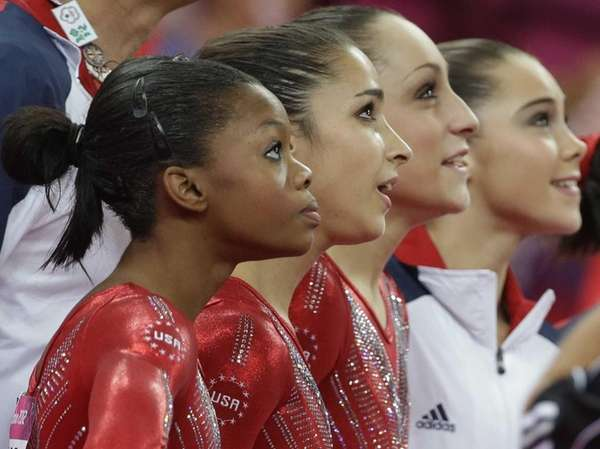U.S. gymnasts, from left to right, Gabrielle Douglas,