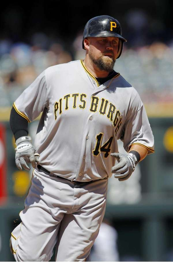 Casey McGehee circles the bases after hitting a
