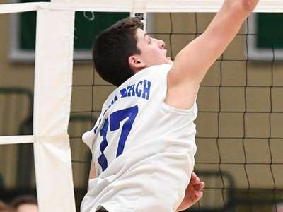 Long BeachÕs Dylan Goldstein spikes the ball against