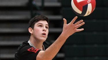 Westhampton BeachÕs Ryan Barnett serves against Long Beach