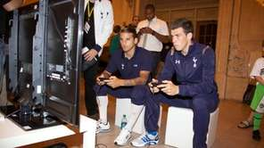 Tottenham Hotspur players check out a demo of