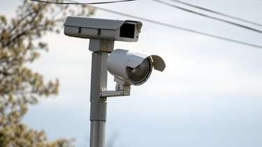 A red light camera at Indian Head Road