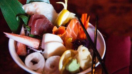 Chirashi, assorted fish served atop sushi rice, at