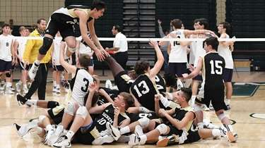 Sachem North players celebrate after defeating Massapequa for