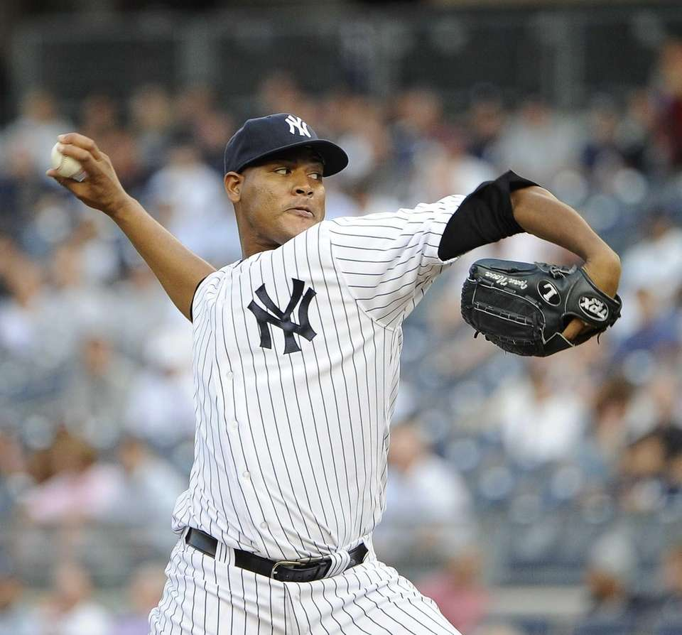 Yankees starter Ivan Nova pitches during the first