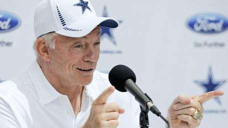 Dallas Cowboys owner Jerry Jones holds a news