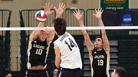 Sachem North middle blocker Christopher Lehnert (10) and