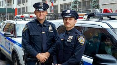 NYPD Officer Tyler Barbour, of Bay Shore, left,