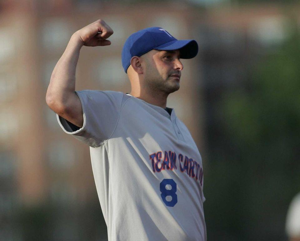 Craig Carton shows his muscle at shortstop as