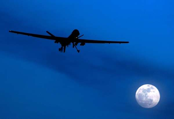 A U.S. Predator drone flies over the moon
