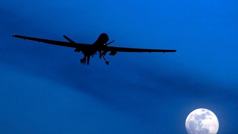 A U.S. Predator drone flies over the moon