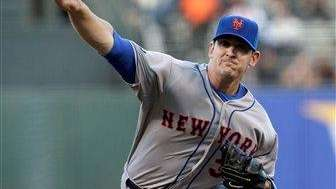 Mets pitcher Matt Harvey delivers during the first