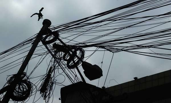 Electric poles and wires in Kolkata, India. (July