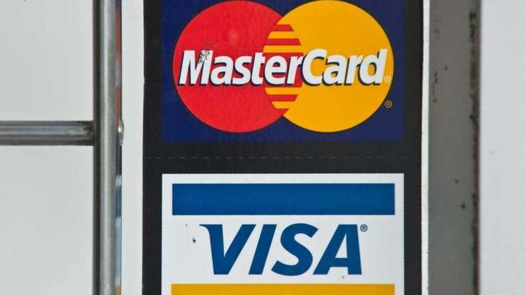 Visa and MasterCard are accused of conspiring to