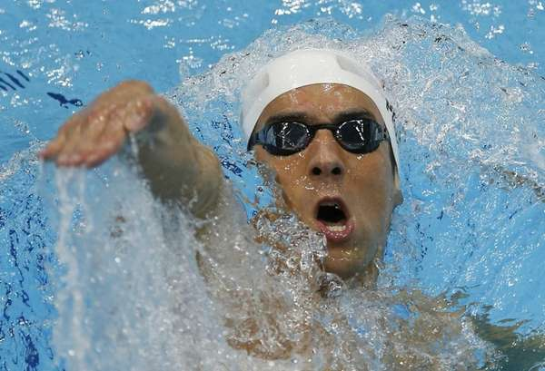 United States' Michael Phelps swims in his men's