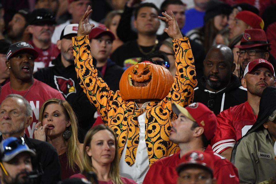 GLENDALE, ARIZONA - OCTOBER 31: A fan dressed