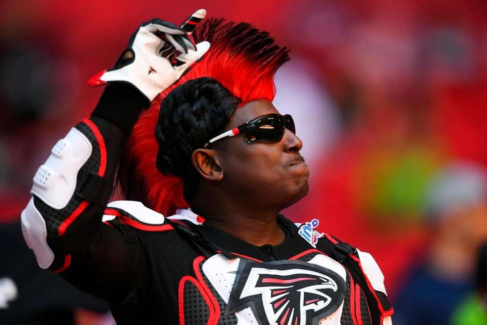 An Atlanta Falcons fan cheers during the first