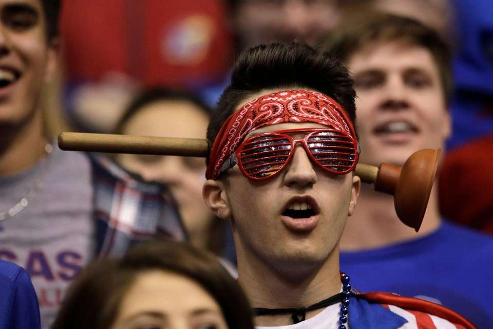 A Kansas fan watches during the first half