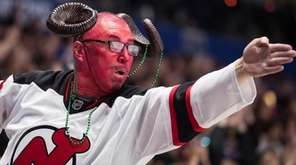 A New Jersey Devils fan wearing face paint