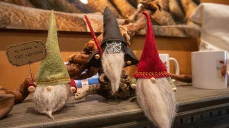 Holiday gnomes mingle with one styled as Darth