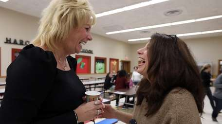 North Merrick School Superintendent Cynthia Seniuk, left, speaks