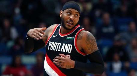 Trail Blazers forward Carmelo Anthony turns down court