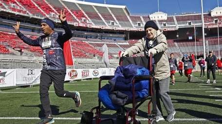 Lois Marge Stroebel, 101, walks the final stretch