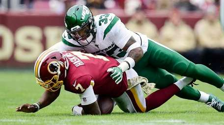 Dwayne Haskins of the Redskins is sacked by
