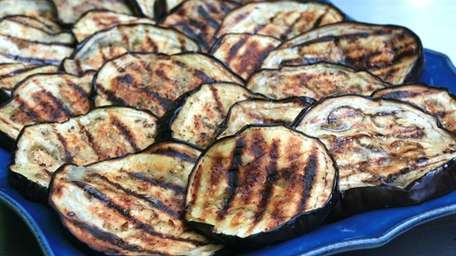 Eggplant is sliced, brushed with a little olive