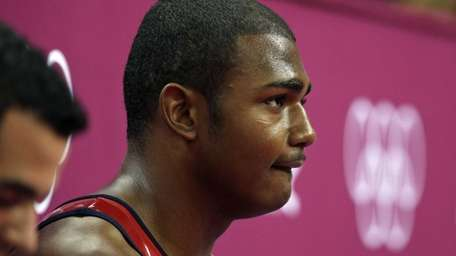 U.S. gymnast John Orozco sits dejected after his
