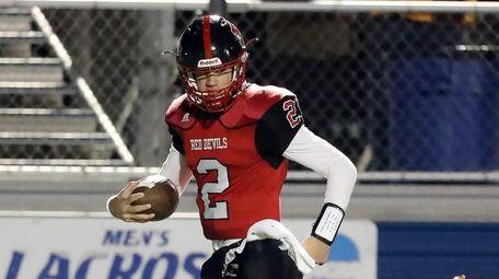Plainedge quarterback Daniel Villari (2) cruises 47 yards