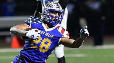 Dominic Sagginario of West Islip lsignals for a