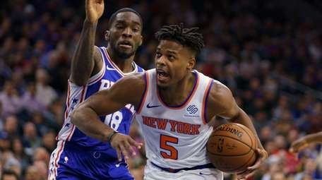 Knicks' Dennis Smith Jr., right, drives to the