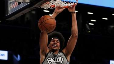 Jarrett Allen #31 of the Nets dunks the