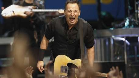 Musician Bruce Springsteen performs with the E Street