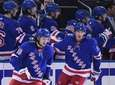 Rangers left wing Artemi Panarin, center, skates after