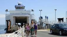 Passengers arrive in Orient Point on the Cross