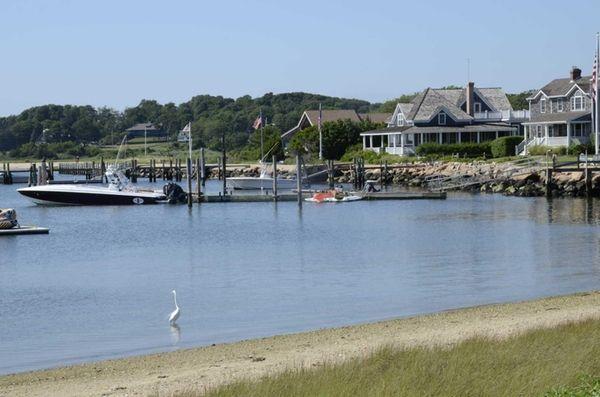 Houses and waterfront rentals overlook Orient Harbor off