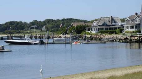 Houses and waterfront rentals overlook Orient Harbor off
