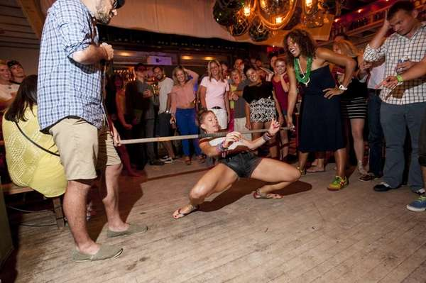 Patrons join in for the limbo contest during