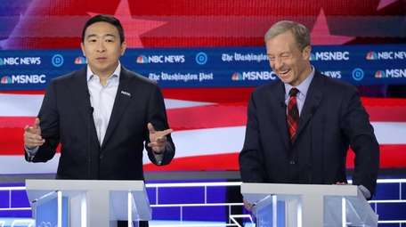 Andrew Yang and Tom Steyer during the fifth